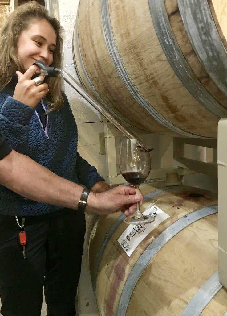 Austin Adventures Guide serving wine from the barrel at Yellowstone Cellars & Winery